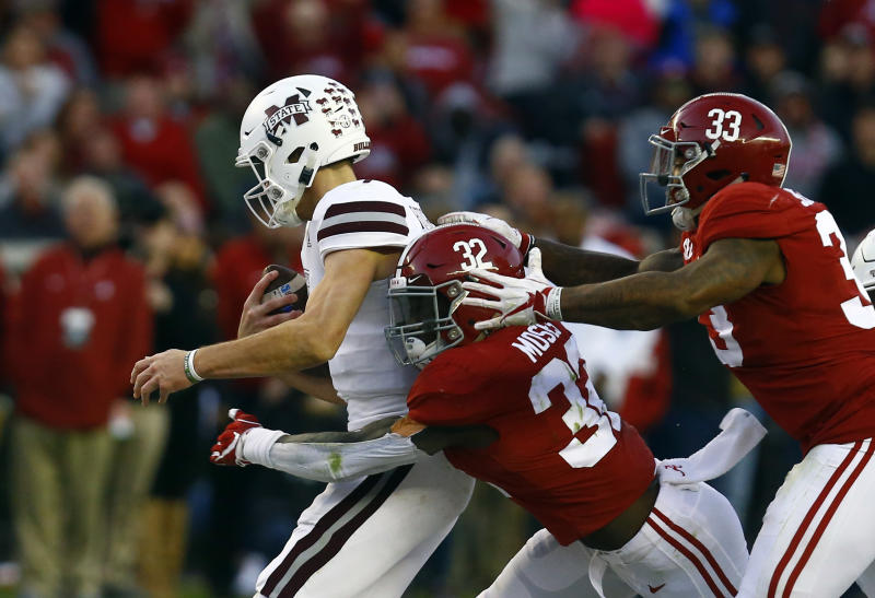 Mississippi State quarterback Nick Fitzgerald (7) is sacked by Alabama linebacker Dylan Moses (32) and linebacker Anfernee Jennings (33) during the second half of an NCAA college football game, Saturday, Nov. 10, 2018, in Tuscaloosa, Ala. Alabama won 24-0. (AP Photo/Butch Dill)