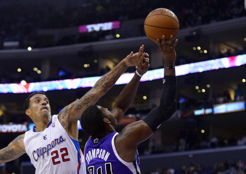 Sacramento Kings power forward Jason Thompson, right, is folded by Los Angeles Clippers small forward Matt Barnes during the first half of their NBA basketball game, Friday, Oct. 25, 2013, in Los Angeles. (AP Photo/Mark J. Terrill)