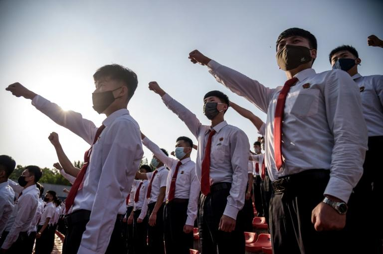 Students and youths attend a mass gathering denouncing 'defectors from the north', at the Pyongyang Youth Park Open-Air Theatre, in Pyongyang, on June 6, 2020