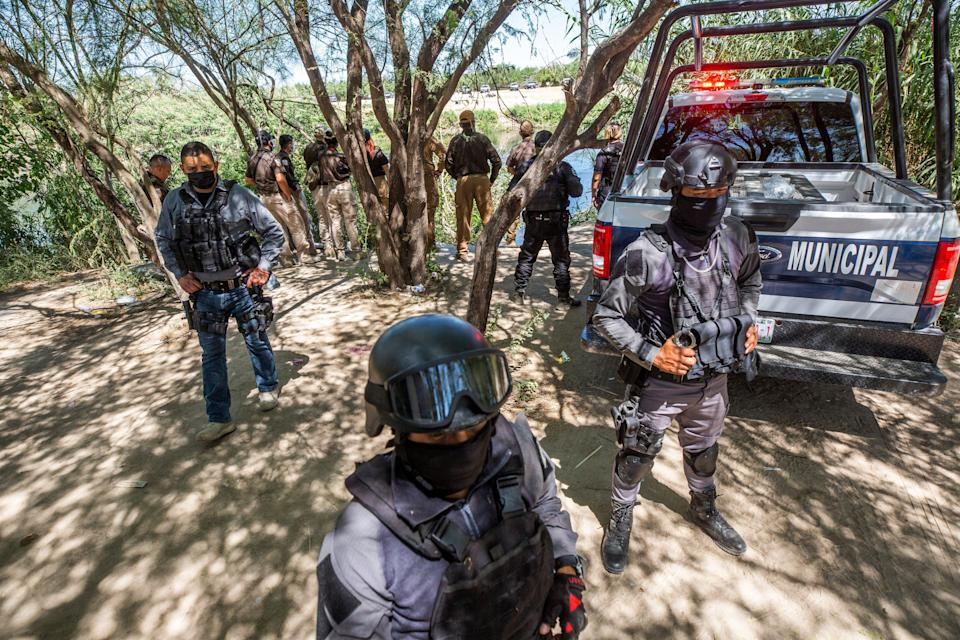 Mexican State Police close access to the Rio Grande immigration officials in Ciudad Acuña after Mexican police entered the Braulio Fernandez Park where the migrants had taken refuge on Thursday Sept. 23, 2021.
