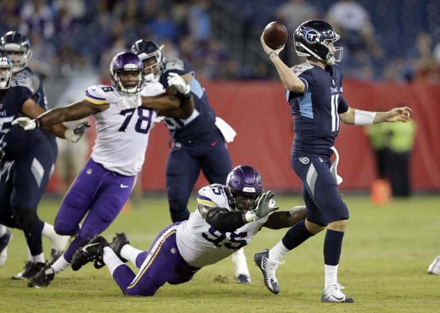 Tennessee Titans quarterback Luke Falk (11) passes as he is pressured by Minnesota Vikings defensive end Ifeadi Odenigbo (95) in the second half of a preseason NFL football game Thursday, Aug. 30, 2018, in Nashville, Tenn. (AP Photo/James Kenney)