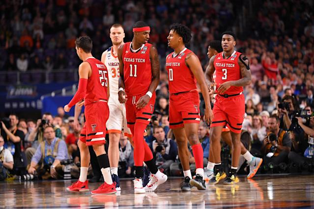 Tariq Owens #11 of the Texas Tech Red Raiders talks with teammate Kyler Edwards #0 of the Texas Tech Red Raiders during the first half in the 2019 NCAA men's Final Four National Championship game at U.S. Bank Stadium on April 08, 2019 in Minneapolis, Minnesota. (Photo by Jamie Schwaberow/NCAA Photos via Getty Images)