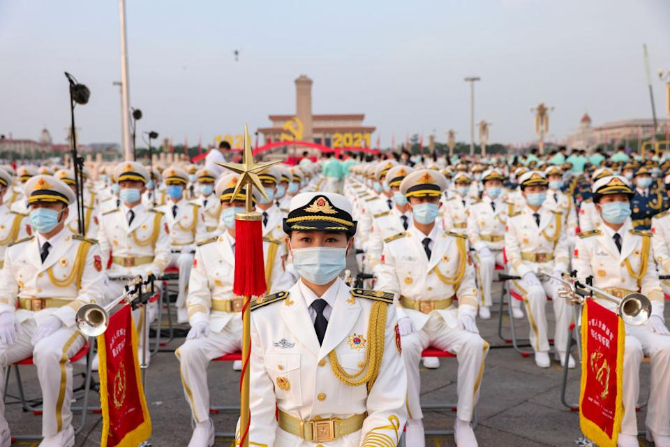 China's military orchestra sit in Tiananmen Square.