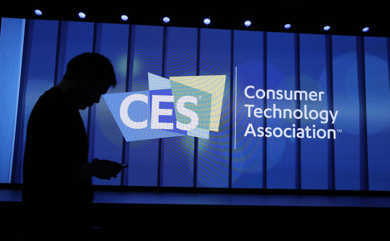A person passes by a sign on a Samsung keynote before the CES technology show, Monday, January 6, 2020, in Las Vegas. (AP Photo / John Locher)