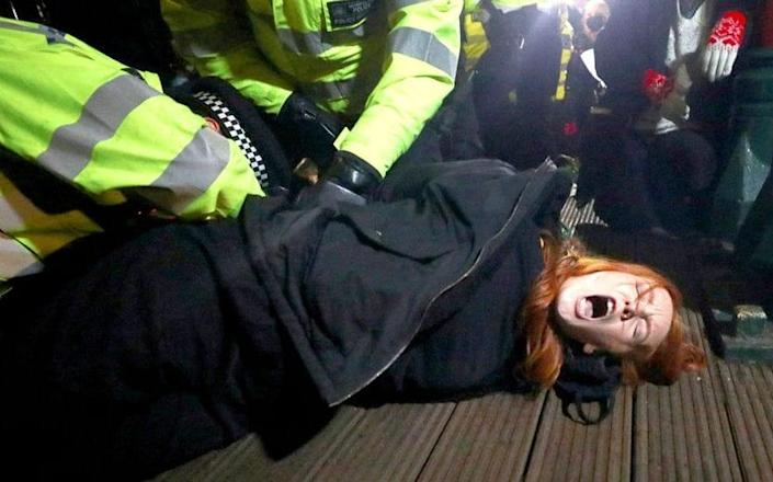 Police detain Patsy Stevenson at the memorial site for Sarah Everard in Clapham Common - Reuters