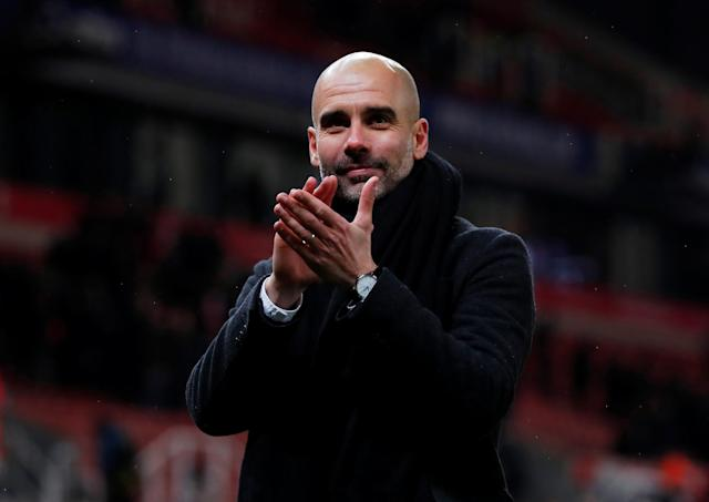 "Soccer Football - Premier League - Stoke City vs Manchester City - bet365 Stadium, Stoke-on-Trent, Britain - March 12, 2018 Manchester City manager Pep Guardiola applauds fans after the match Action Images via Reuters/Andrew Couldridge EDITORIAL USE ONLY. No use with unauthorized audio, video, data, fixture lists, club/league logos or ""live"" services. Online in-match use limited to 75 images, no video emulation. No use in betting, games or single club/league/player publications. Please contact your account representative for further details."