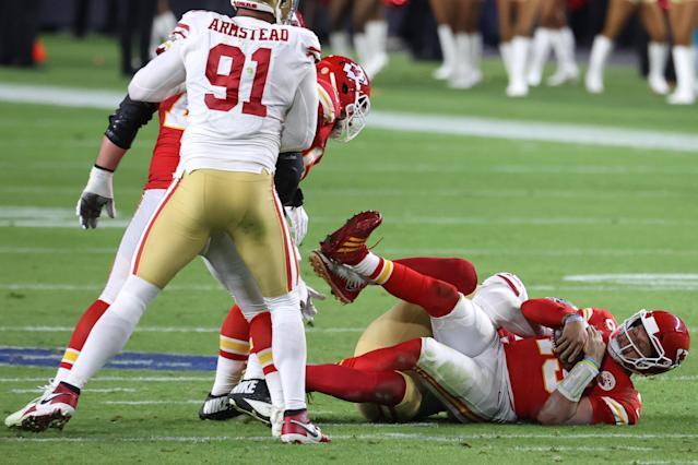 MIAMI, FLORIDA - FEBRUARY 02: Patrick Mahomes #15 of the Kansas City Chiefs is sacked by DeForest Buckner #99 of the San Francisco 49ers during the third quarter in Super Bowl LIV at Hard Rock Stadium on February 02, 2020 in Miami, Florida. (Photo by Al Bello/Getty Images)