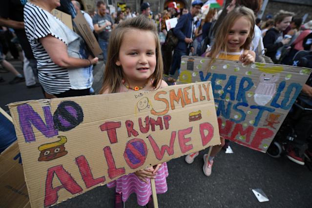 <p>Young girls hold anti-Trump signs during a protest in Edinburgh, Scotland, while the U.S. president visits Trump Turnberry Luxury Collection Resort on his visit to the United Kingdom, July 14, 2018. (Photo: Jeff J. Mitchell/Getty Images) </p>