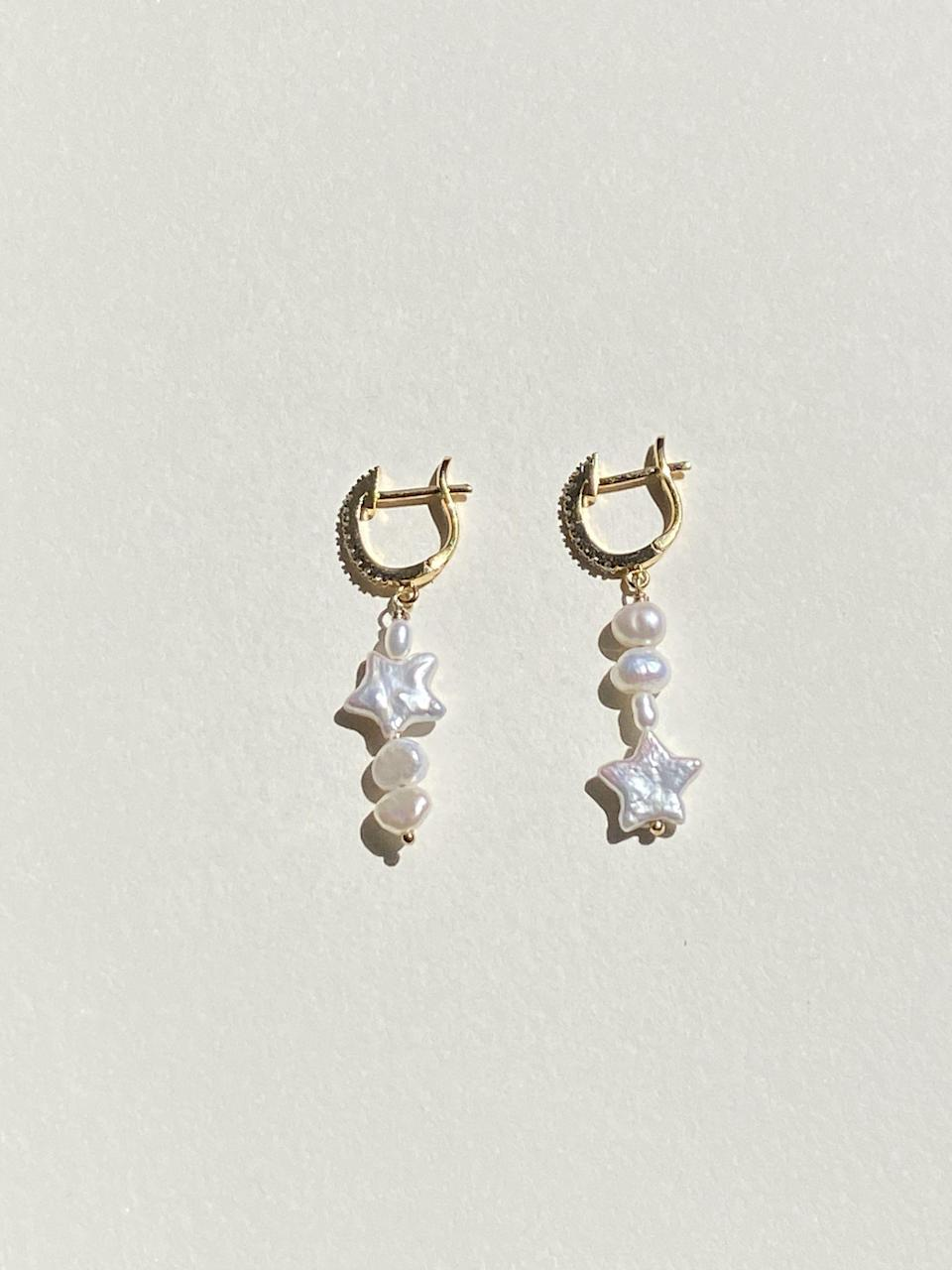 """<p><strong>Bebe Rouge</strong></p><p>bebe-rouge.com</p><p><strong>$52.00</strong></p><p><a href=""""https://bebe-rouge.com/collections/earrings/products/luna-hopps"""" rel=""""nofollow noopener"""" target=""""_blank"""" data-ylk=""""slk:Shop Now"""" class=""""link rapid-noclick-resp"""">Shop Now</a></p><p>Okay, name something cuter than freshwater pearls in the shape of a star. No, seriously. I'll wait.</p>"""