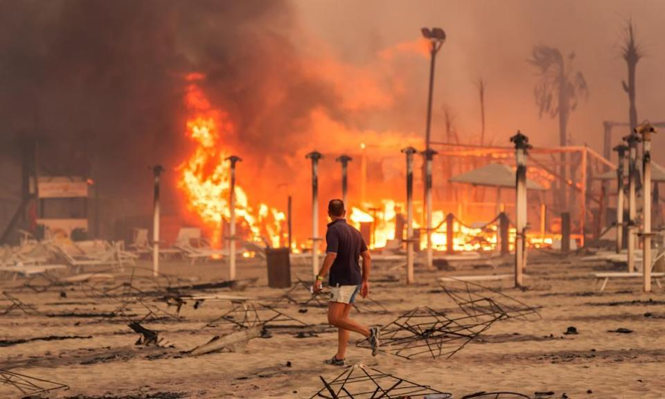 Wildfires at Le Capannine beach in Catania, Sicily, on 30 July.