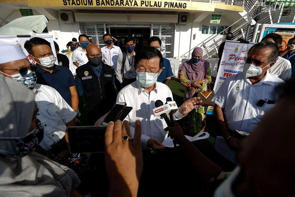 Penang Chief Minister Chow Kon Yeow speaks to reporters during a visit to the City Stadium in George Town July 5, 2021. — Picture by Sayuti Zainudin