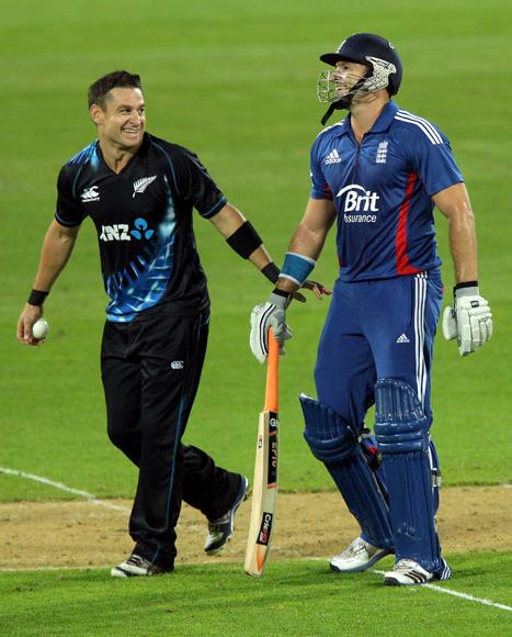 Nathan McCullum of New Zealand shares a laugh with Michael Lumb of England during the third Twenty20 International match between New Zealand and England at Westpac Stadium on February 15, 2013 in Wellington, New Zealand.  (Photo by Hagen Hopkins/Getty Images)
