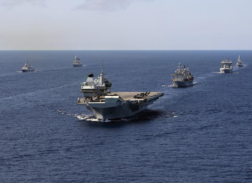 China has warned Britain to 'remain restrained and obey the rules' as the Royal Navy's carrier strike group (CSG) sails through the South China Sea  (PA Media)