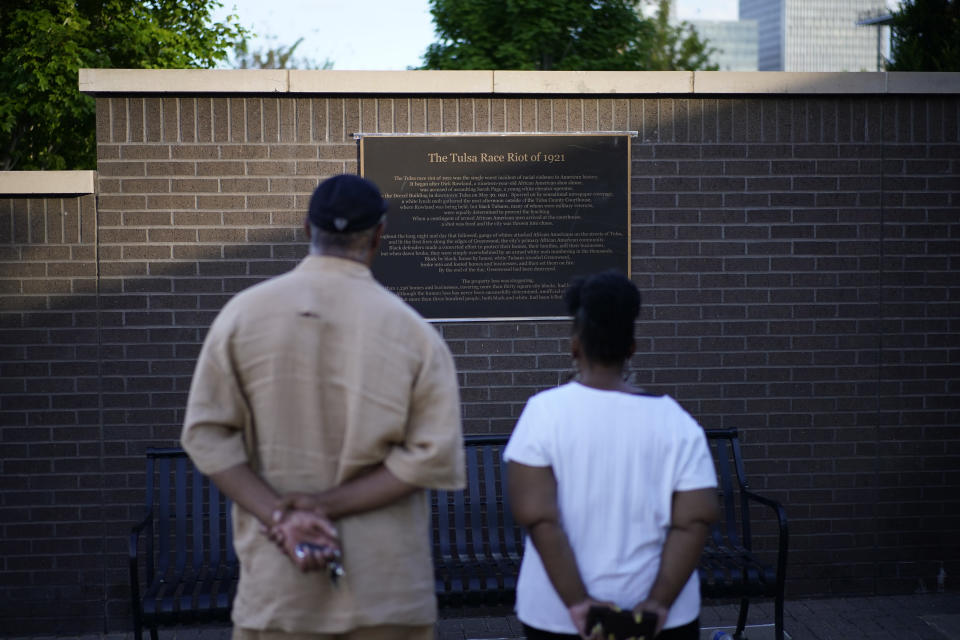 """Demetrius Boyd, left, and Loretta Boyd visit the John Hope Franklin Reconciliation Park, Wednesday, May 26, 2021, in Tulsa, Okla. The two, from Tulsa, visited the park memorializing the Tulsa Race Massacre ahead of the 100 year anniversary. """"History and education, and you have a sense of calmness and peace,"""" said Demetrius Boyd about visiting the park for the first time. (AP Photo/John Locher)"""