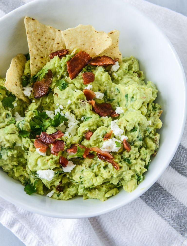 """<p>Adding crispy bacon and creamy goat cheese to your guac gives it a more hearty, wintery spin—and the pop of festive green doesn't hurt!</p><p><strong><a href=""""https://www.thepioneerwoman.com/food-cooking/recipes/a83269/bacon-goat-cheese-guacamole/"""" rel=""""nofollow noopener"""" target=""""_blank"""" data-ylk=""""slk:Get the recipe."""" class=""""link rapid-noclick-resp"""">Get the recipe.</a></strong></p><p><strong><a class=""""link rapid-noclick-resp"""" href=""""https://go.redirectingat.com?id=74968X1596630&url=https%3A%2F%2Fwww.walmart.com%2Fsearch%2F%3Fquery%3Dpioneer%2Bwoman%2Bserving%2Bbowls&sref=https%3A%2F%2Fwww.thepioneerwoman.com%2Ffood-cooking%2Fmeals-menus%2Fg34272733%2Fchristmas-party-appetizers%2F"""" rel=""""nofollow noopener"""" target=""""_blank"""" data-ylk=""""slk:SHOP SERVING BOWLS"""">SHOP SERVING BOWLS</a><br></strong></p>"""
