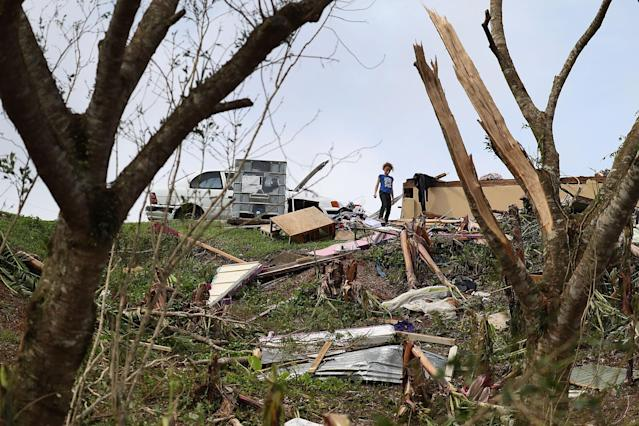 <p>Karlian Mercado,7, walks among the rubble that remains of her families home September 24, 2017 in Hayales de Coamo, Puerto Rico. Puerto Rico experienced widespread damage after Hurricane Maria, a category 4 hurricane, passed through. (Photo: Joe Raedle/Getty Images) </p>