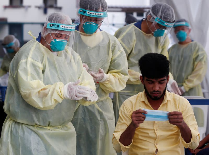 Singapore looks to restart economy with phased easing of virus curbs