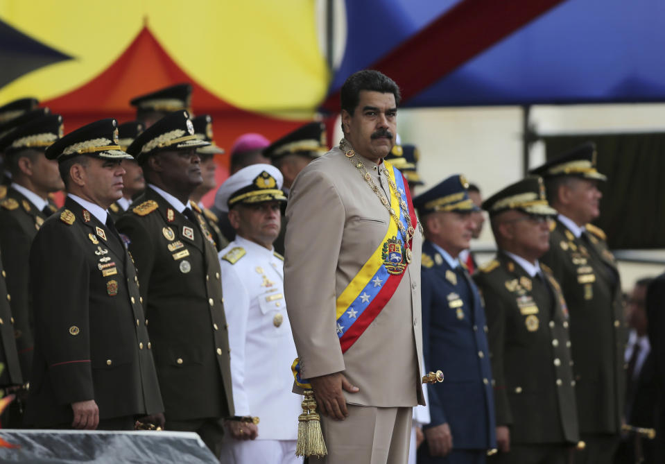 In this June 24, 2017 file photo, Venezuela's President Nicolas Maduro oversees a military parade on Army Day at Fort Tiuna in Caracas, Venezuela. (AP Photo/Fernando Llano)