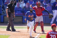 New York Mets' Luis Guillorme, center, draws a walk off St. Louis Cardinals relief pitcher Jordan Hicks during the fifth inning of a spring training baseball game, Sunday, March 14, 2021, in Port St. Lucie, Fla. (AP Photo/Lynne Sladky)