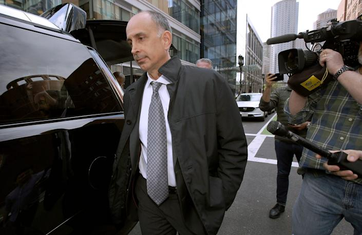 Stephen Semprevivo is seen leading a federal courthouse in Boston on May 7, after pleading guilty to paying $400,000 to get his son Adam into Georgetown.
