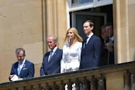 Ivanka Trump (C) and her husband Jared Kushner (R) watch from a balcony as President Trump and First Lady Melania arrive. (MANDEL NGAN / AFP/Getty Images)