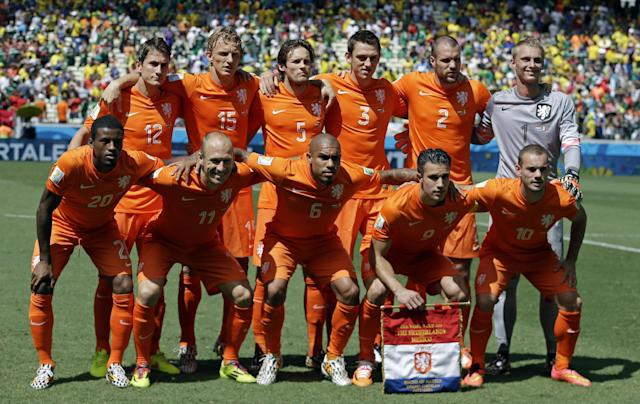 The Dutch team pose for a group photo before the World Cup round of 16 soccer match between the Netherlands and Mexico at the Arena Castelao in Fortaleza, Brazil, Sunday, June 29, 2014. (AP Photo/Natacha Pisarenko)
