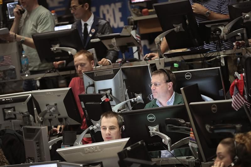 CHICAGO, IL - MARCH 03: Traders in the Volatility Index (VIX) pit at the Chicago Board Options Exchange (CBOE) fill orders March 3, 2017 in Chicago, Illinois. While speaking in Chicago today Fed Chair Janet Yellen hinted that an interest rate hike will probably occur later this month. (Photo by Scott Olson/Getty Images)