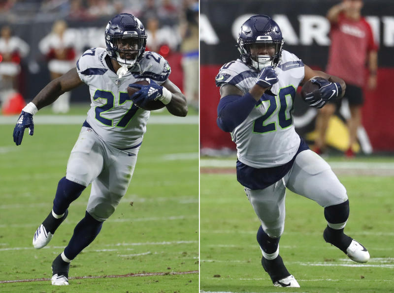 FILE - These are Sept 30, 2018, file photos, showing Seattle Seahawks running backs Mike Davis (27) and Rashaad Penny (20) running against the Arizona Cardinals during an NFL football game, in Glendale, Ariz. Rather than trying to be equitable as the Seahawks were through the first two weeks, the decision was made to make Chris Carson the primary ball carrier. No more splitting carries just for the sake of doing so. Only when Carson needed a break would another back get their chance. (AP Photo/Rick Scuteri, File)