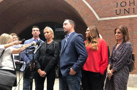 Michael DiSarro (L to R), Pamela DiSarro, Nick DiSarro and Colby DiSarro speak to reporters outside the federal courthouse following the sentencing of Francis Salemme in Boston, Massachusetts, U.S., September 13, 2018.  REUTERS/Nate Raymond