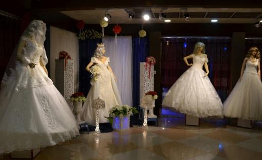 Wedding dresses are displayed in a showroom in the northern Iraqi city of Mosul on February 6, 2018
