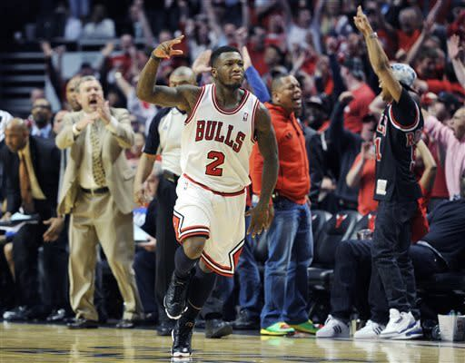 Chicago Bulls' Nate Robinson (2) celebrates a basket against the Brooklyn Nets during the second overtime in Game 4 of their first-round NBA basketball playoff series Saturday, April 27, 2013, in Chicago. The Bulls won 142-134 in three overtimes. (AP Photo/Jim Prisching)