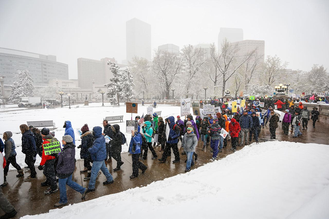 <p>Thousands of protestors march around downtown Denver at the People's Climate March on Denver on April 29, 2017 in Denver, Colorado. The protest, which focused on climate change, coincided with President Donald Trump's 100th day in office. (Marc Piscotty/Getty Images) </p>