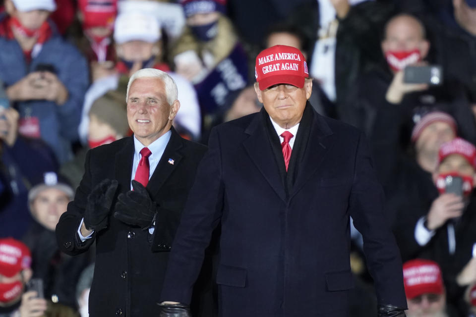 President Donald Trump arrives with Vice President Mike Pence for a campaign rally Monday, Nov. 2, 2020, in Grand Rapids, Mich. (AP Photo/Carlos Osorio)