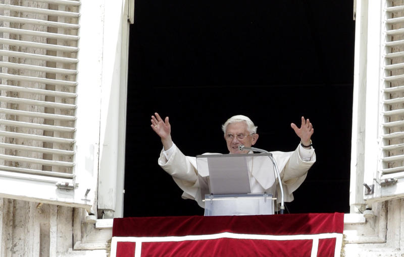 Pope Benedict XVI waves to faithful during the Angelus prayer from his studio overlooking St. Peter's square at the Vatican, Sunday, July 1, 2012. (AP Photo/Riccardo De Luca)