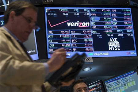A trader works by the post where Verizon is traded on the floor of the New York Stock Exchange February 21, 2014. REUTERS/Brendan McDermid