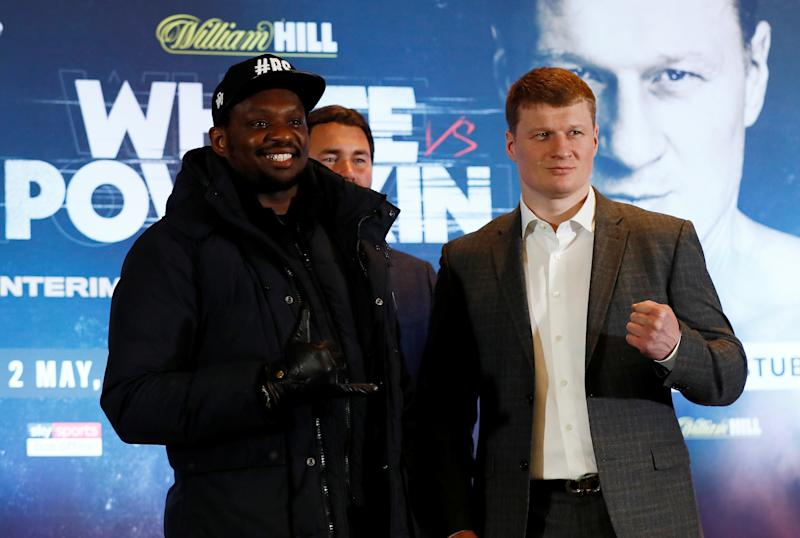 Boxing - Dillian Whyte & Alexander Povetkin Press Conference - Mercure Manchester Piccadilly Hotel, Manchester, Britain - March 4, 2020 Dillian Whyte and Alexander Povetkin pose with promoter Eddie Hearn after the press conference Action Images via Reuters/Jason Cairnduff