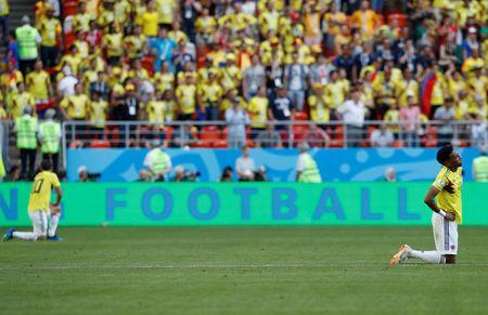 Soccer Football - World Cup - Group H - Colombia vs Japan - Mordovia Arena, Saransk, Russia - June 19, 2018 Colombia's Johan Mojica and James Rodriguez look dejected after the match REUTERS/Darren Staples
