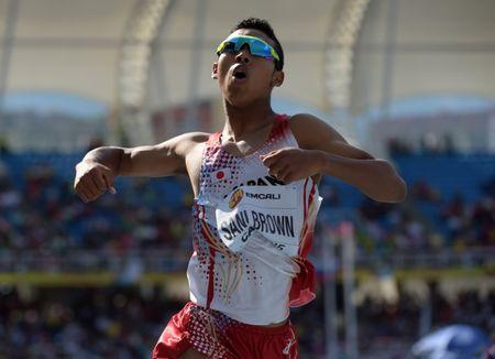 Jul 19, 2015, Cali, Columbia; Abdul Hakim Sani Brown (JPN) celebrates after winning the 200m in a championship record 20.34 during the 2015 IAAF World Youth Championships at Estadio Olimpico Pascual Guerrero. Kirby Lee-USA TODAY Sports