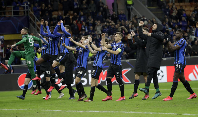 "FILE - In this Wednesday, Feb. 19, 2020 file photo, Atalanta players celebrate at the end of the Champions League round of 16, first leg, soccer match between Atalanta and Valencia at the San Siro stadium in Milan, Italy. It was the biggest soccer game in Atalanta's history and a third of Bergamo's population made the short trip to Milan's famed San Siro Stadium to witness it. Nearly 2,500 fans of visiting Spanish club Valencia also traveled to the Champions League match. More than a month later, experts are pointing to the Feb. 19 game as one of the biggest reasons why Bergamo has become one of the epicenters of the coronavirus pandemic — a ""biological bomb"" was the way one respiratory specialist put it — and why 35% of Valencia's team became infected. The new coronavirus causes mild or moderate symptoms for most people, but for some, especially older adults and people with existing health problems, it can cause more severe illness or death. (AP Photo/Luca Bruno, File)"