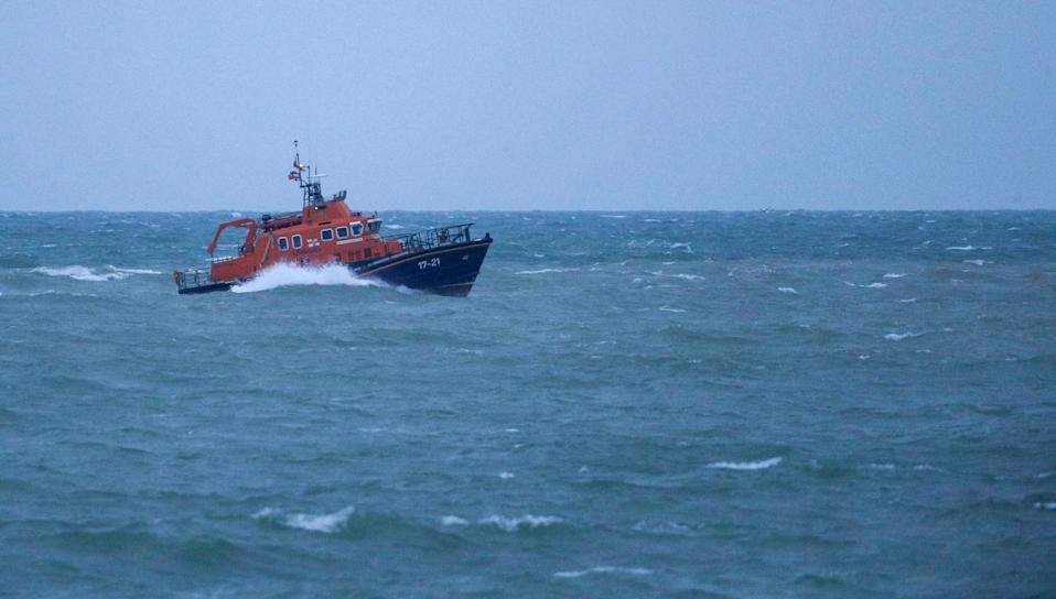 The RNLI severn class Lifeboat head to Newhaven harbour after searching for the missing two fishermen that went missing near Seaford, Sussex, when their fishing boat,  Joanna C, sank off the coast near Seaford, East Sussex on Saturday.  (Steve Parsons/PA Wire)