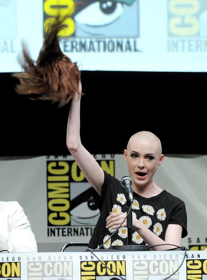"SAN DIEGO, CA - JULY 20: (L-R) Actor Karen Gillan speaks onstage at Marvel Studios ""Guardians of the Galaxy"" during Comic-Con International 2013 at San Diego Convention Center on July 20, 2013 in San Diego, California. (Photo by Kevin Winter/Getty Images)"