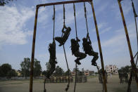 Special police officer recruits who completed nearly three months physical training demonstrate their skills at Kathua in Indian-controlled Kashmir, Saturday, June 5, 2021. Special police officers are lower-ranked police officials who are mainly recruited for intelligence gathering and counterinsurgency operations. In recent years, the force has assisted in border areas as well because of local recruits' familiarity with the topography and ability to assist police and border guards during emergencies. (AP Photo/Channi Anand)