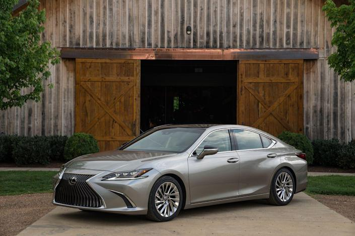 """<p><a href=""""https://www.caranddriver.com/lexus/es"""" rel=""""nofollow noopener"""" target=""""_blank"""" data-ylk=""""slk:The 2019 Lexus ES300h"""" class=""""link rapid-noclick-resp"""">The 2019 Lexus ES300h</a> benefits from an all-new design and is based on the same component set that underpins the Toyota Avalon. Happily, it maintains its signature quiet, elegant demeanor while offering up to 44 mpg combined, a figure strong enough to make it one of the most fuel-efficient luxury vehicles on the road. Its performance is tepid—this is no performance hybrid, mind you—but the Lexus makes up for it with a well-appointed cabin loaded with features.<br></p>"""