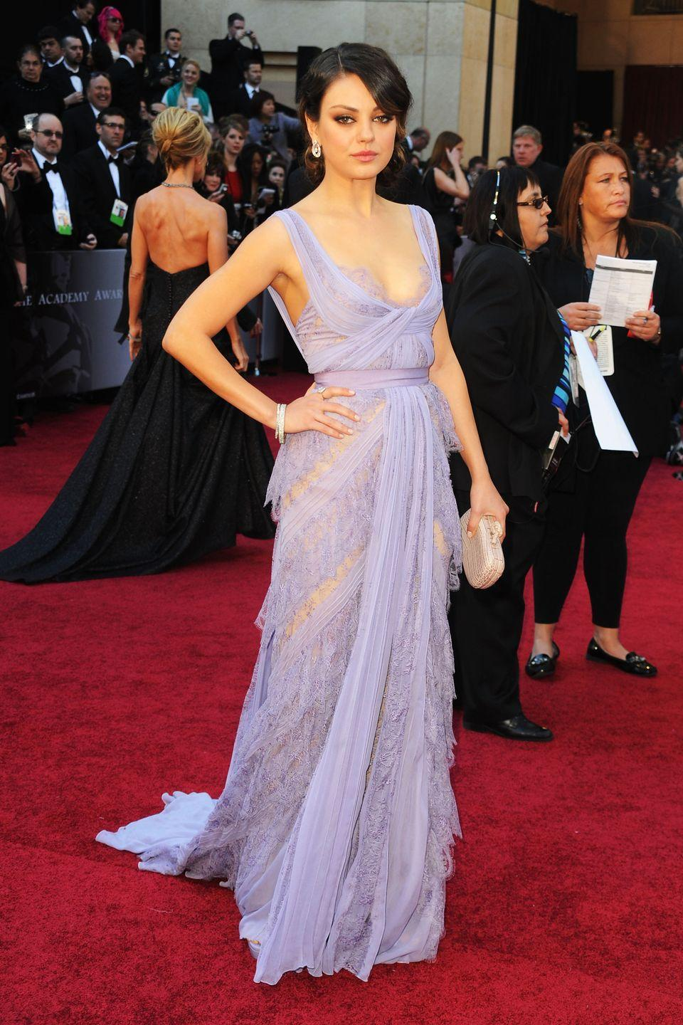 <p>Mila Kunis' lilac moment on the red carpet particularly stands out, because it was a refreshing contrast to her typically low-key, androgynous style. The actress looked angelic in this semi-sheer Elie Saab gown with feminine lace detailing - the distinctive soft purple hue making it memorable for all the right reasons.</p>