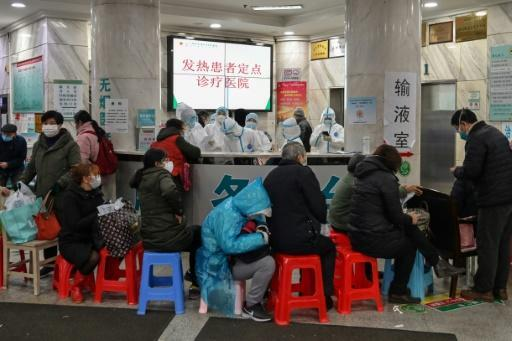 Medical facilities in the Chinese city of Wuhan are swamped with patients waiting for hours to see doctors