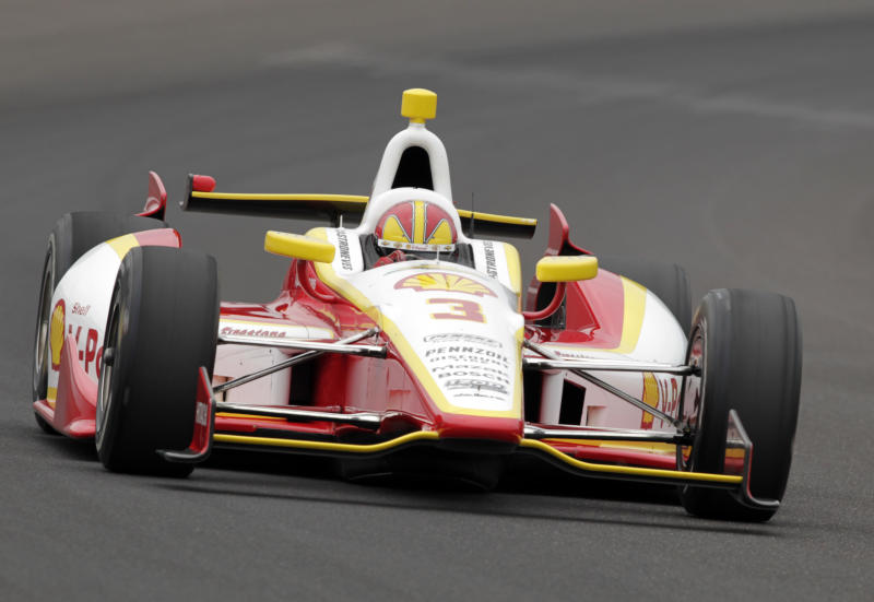 Helio Castroneves, of Brazil, drives through the first turn on his qualification run on the first day of qualifications for the Indianapolis 500 auto race at Indianapolis Motor Speedway in Indianapolis, Saturday, May 18, 2013. (AP Photo/AJ Mast)