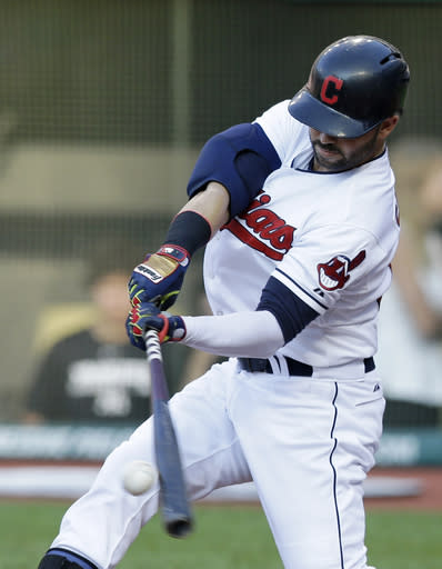 Cleveland Indians' Nick Swisher hits a two-RBI single off New York Yankees' Brandon McCarthy in the first inning of a baseball game Wednesday, July 9, 2014, in Cleveland. Michael Brantley and Carlos Santana scored on the play. (AP Photo/Tony Dejak)