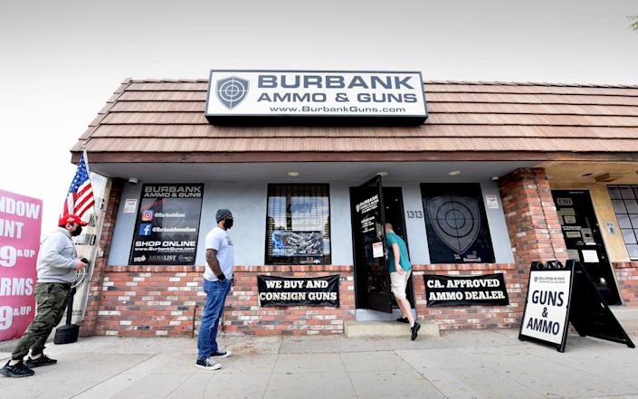A steady stream of people wait patiently outside of the Burbank Ammo & Guns - Jeff Rayner/Coleman-Rayner