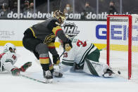 Vegas Golden Knights left wing Max Pacioretty (67) scores against Minnesota Wild goaltender Cam Talbot (33) during overtime of an NHL hockey game Monday, March 1, 2021, in Las Vegas. (AP Photo/John Locher)