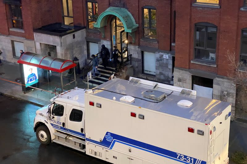 People leave the offices of gaming software developer Ubisoft during a police security operation in Montreal